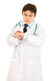 Concentrated medical doctor looking at  clock Royalty Free Stock Photo