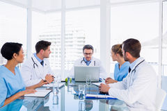 Concentrated medical team around desk Stock Photo