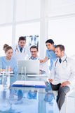 Concentrated medical team using laptop together Royalty Free Stock Image