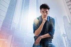 Concentrated model with a hand under his chin Royalty Free Stock Image