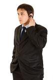 Concentrated modern businessman with handsfree Royalty Free Stock Photo