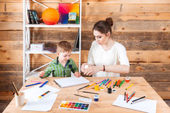Concentrated mother and little son drawing in art school Stock Photography