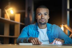 Concentrated mulatto looking straight at camera Stock Photos