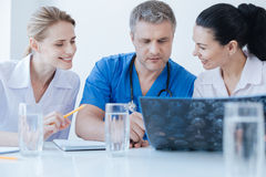 Concentrated neurologists examining ct brain photo at the laboratory Royalty Free Stock Image