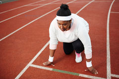 Concentrated overweight African woman preparing for run on starting line. Ready to face run challenge Stock Photography