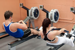 Concentrated people using a rower Royalty Free Stock Photography
