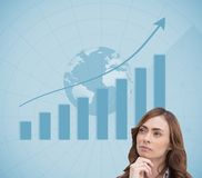 Concentrated pretty brunette looking at statistic Stock Image