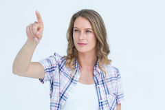 Concentrated pretty hipster pointing with her finger Royalty Free Stock Images