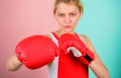 Concentrated on punch. Woman boxing gloves focused on attack. Ambitious girl fight boxing gloves. Female rights. I am. Gonna kick you off. Confident in her stock photography