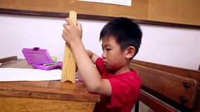 Concentrated pupil using abacus. In classroom at the elementary school stock footage