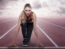Concentrated runner in starting position. On the racetrack Stock Image