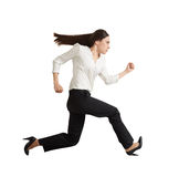 Concentrated running businesswoman Stock Photo