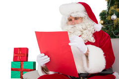 Concentrated santa writing a list Royalty Free Stock Photos