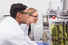 Concentrated scientists observing together Stock Photo
