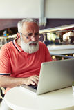 Concentrated senior man using laptop Royalty Free Stock Images