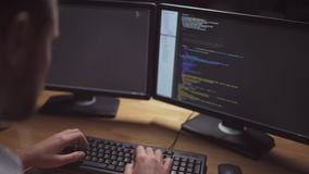 Concentrated software developer writing programming code stock video footage