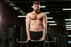 Concentrated sports man make sport exercises Stock Photography