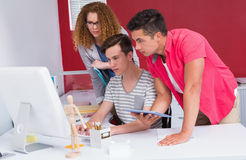 Concentrated students using computer and tablet Stock Photo