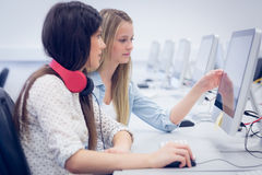 Concentrated students using computer Royalty Free Stock Photography