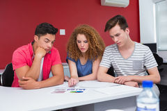 Concentrated students working together Stock Photo