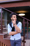 Concentrated stylish young man of Muslim appearance looks from s Stock Photo