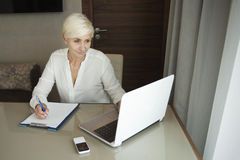 Concentrated successful businesswoman working on laptop Stock Images