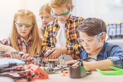 Concentrated team of little technician Stock Images