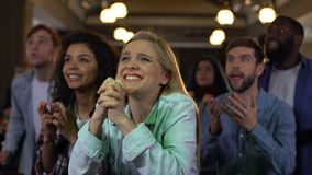 Concentrated team supporters cheering for goal, sport fans entertainment, joy. Stock footage stock footage