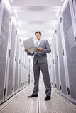 Concentrated technician in suit standing Royalty Free Stock Photos