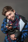 Concentrated teenage boy with joy-stick Stock Images