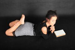 Free Concentrated Teenage Schoolgirl With Book Royalty Free Stock Images - 186775349