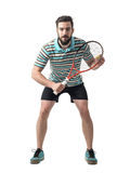 Concentrated tennis player bending and waiting for serve. Royalty Free Stock Images