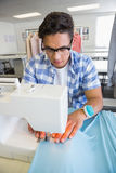 Concentrated university student sewing Stock Image