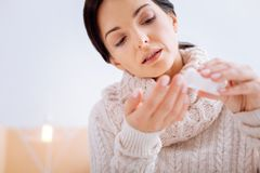Concentrated woman being responsible while taking pills Royalty Free Stock Photo