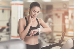 Concentrated woman controlling her pulse after sport Stock Photo