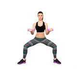 Concentrated woman doing fitness Stock Photo
