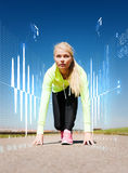 Concentrated woman doing running outdoors Stock Images