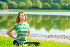 Concentrated woman doing yoga Stock Photos