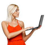 Concentrated Woman Looking At Laptop Screen Stock Photo