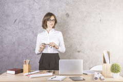 Concentrated woman at office desk Royalty Free Stock Image