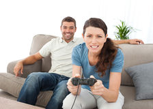 Concentrated woman playing video games Royalty Free Stock Image