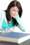 Concentrated woman studying Stock Photography