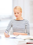 Concentrated woman studying in college Stock Photography