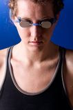 Concentrated woman swimmer Stock Photos