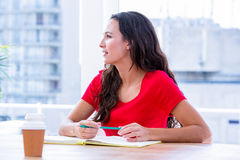 Concentrated woman taking notes during a meeting Royalty Free Stock Image