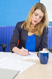 Concentrated woman working Royalty Free Stock Photos