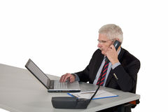 Concentrated working senior manager Royalty Free Stock Images