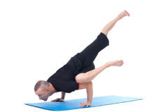 Concentrated yogi doing difficult asana in studio Stock Images