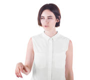 A concentrated young business woman is telling a story, isolated on a white background. A cute girl with a short dark haircut, isolated on a white background. A Royalty Free Stock Image