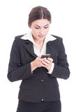 Concentrated young business woman texting on smartphone. Isolated on white background Stock Photography